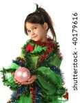 Little smiling girl in green Christmas tree costume with pink Christmas decoration - stock photo
