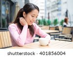 young woman having her coffee | Shutterstock . vector #401856004