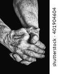 Old Woman Clasped In Her Hands...