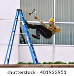 A Worker Falls From Ladder...