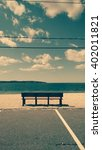 Small photo of solitary bench at the beach. Vintage cross processed. Beach, meditation, summer, solitude, and outdoors concept