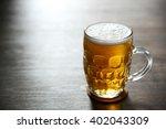 glass mug of light beer on... | Shutterstock . vector #402043309