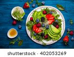 mixed salad leaves with berries ... | Shutterstock . vector #402053269
