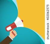 megaphone in human hand.... | Shutterstock .eps vector #402062575