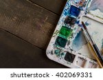 watercolor paint tray with brush | Shutterstock . vector #402069331