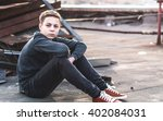 lonely teenager sitting on roof ...   Shutterstock . vector #402084031