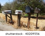A Row Of Mail Boxes In A Rura...