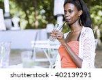 stunning african woman drinking ... | Shutterstock . vector #402139291