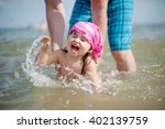 Daddy Teaches Daughter To Swim