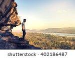 asia tourist on the sharp peak... | Shutterstock . vector #402186487