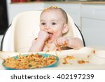 a little b eating her dinner... | Shutterstock . vector #402197239