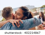 woman greeting her boyfriend... | Shutterstock . vector #402214867