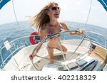 young lady at the helm of a... | Shutterstock . vector #402218329