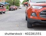 car parking front home on street | Shutterstock . vector #402281551