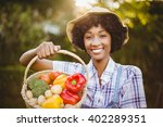 Smiling Woman Showing A Basket...