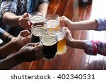 friends drinking beer in pub | Shutterstock . vector #402340531