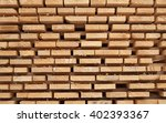 stack of new wooden studs at... | Shutterstock . vector #402393367