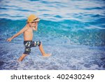 young tanned boy in hat ... | Shutterstock . vector #402430249