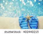flip flops by the swimming pool | Shutterstock . vector #402440215