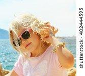 little girl listening to the... | Shutterstock . vector #402444595
