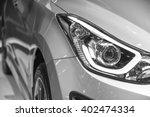 Stock photo headlight of new automobile 402474334