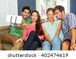 joyful friends taking selfie... | Shutterstock . vector #402474619