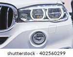 headlight of a modern luxury... | Shutterstock . vector #402560299
