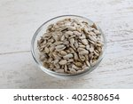 peeled sunflower seeds on the... | Shutterstock . vector #402580654