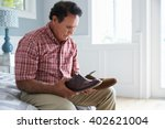 senior hispanic man suffering... | Shutterstock . vector #402621004