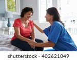 nurse making home visit to... | Shutterstock . vector #402621049