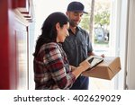 woman signing for package from... | Shutterstock . vector #402629029