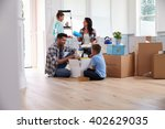 hispanic family moving into new ... | Shutterstock . vector #402629035