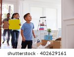 hispanic family moving into new ... | Shutterstock . vector #402629161