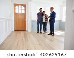 realtor showing hispanic couple ... | Shutterstock . vector #402629167