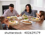 hispanic family enjoying meal... | Shutterstock . vector #402629179