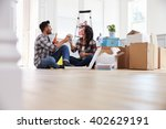 couple celebrating moving into... | Shutterstock . vector #402629191