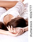 woman lying in bedroom smiling...   Shutterstock . vector #40267777