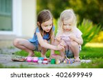 two cute little sisters... | Shutterstock . vector #402699949