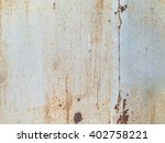 rust on dirty old painted metal | Shutterstock . vector #402758221