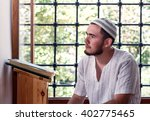bearded man praying in the... | Shutterstock . vector #402775465