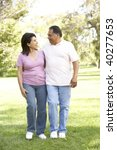 senior couple walking in park | Shutterstock . vector #40277653