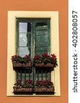 window with flowers in italy | Shutterstock . vector #402808057