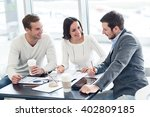 cheerful colleagues discussing... | Shutterstock . vector #402809185