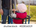 Small Child On A Swing On The...