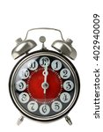 Small photo of old windup loud alarm clock isolated on white background