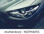 headlight of a modern luxury... | Shutterstock . vector #402946051