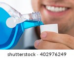 close up of young man pouring... | Shutterstock . vector #402976249