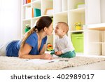 happy family playing at home on ... | Shutterstock . vector #402989017