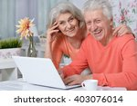 happy senior couple with laptop | Shutterstock . vector #403076014