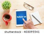 tablet with text inside follow... | Shutterstock . vector #403095541